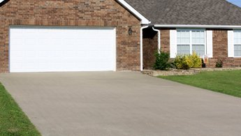Concrete driveway after pressure washing services