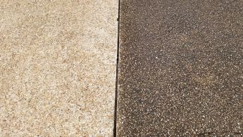 Aggregate driveway during pressure washing
